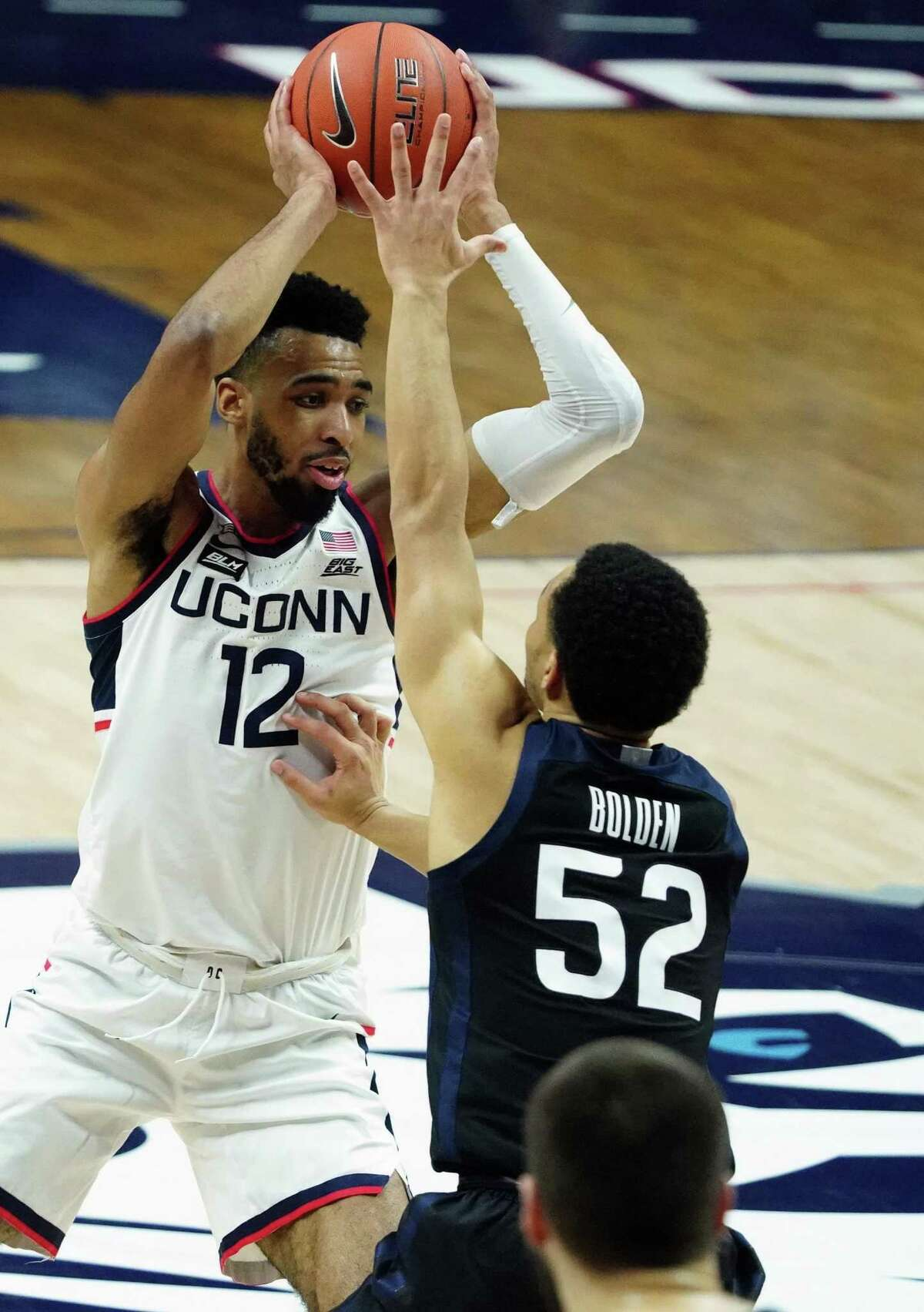 UConn's Tyler Polley (12) controls the ball against Butler .