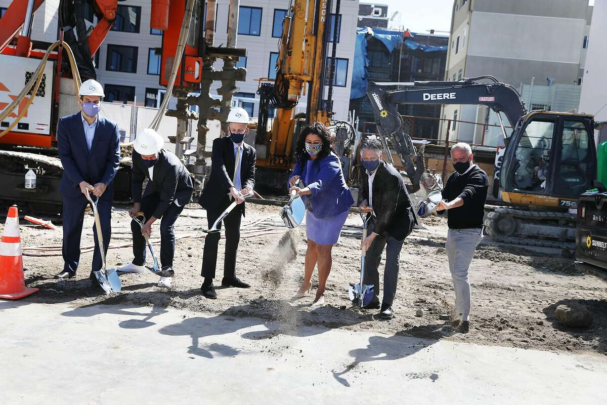S.F. Mayor London Breed (center right) wields a ceremonial shovel at the groundbreaking for a supportive housing complex.