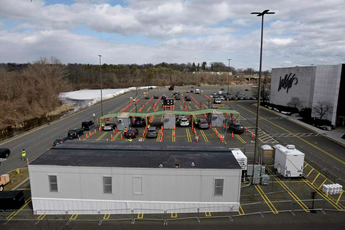Danbury's first mass COVID-19 vaccination site opened on Thursday at the Danbury Fair mall. The Community Health Center, Inc site will utilize six car lanes to serve 600 appointments a day. March 4, 2021, in Danbury, Conn.
