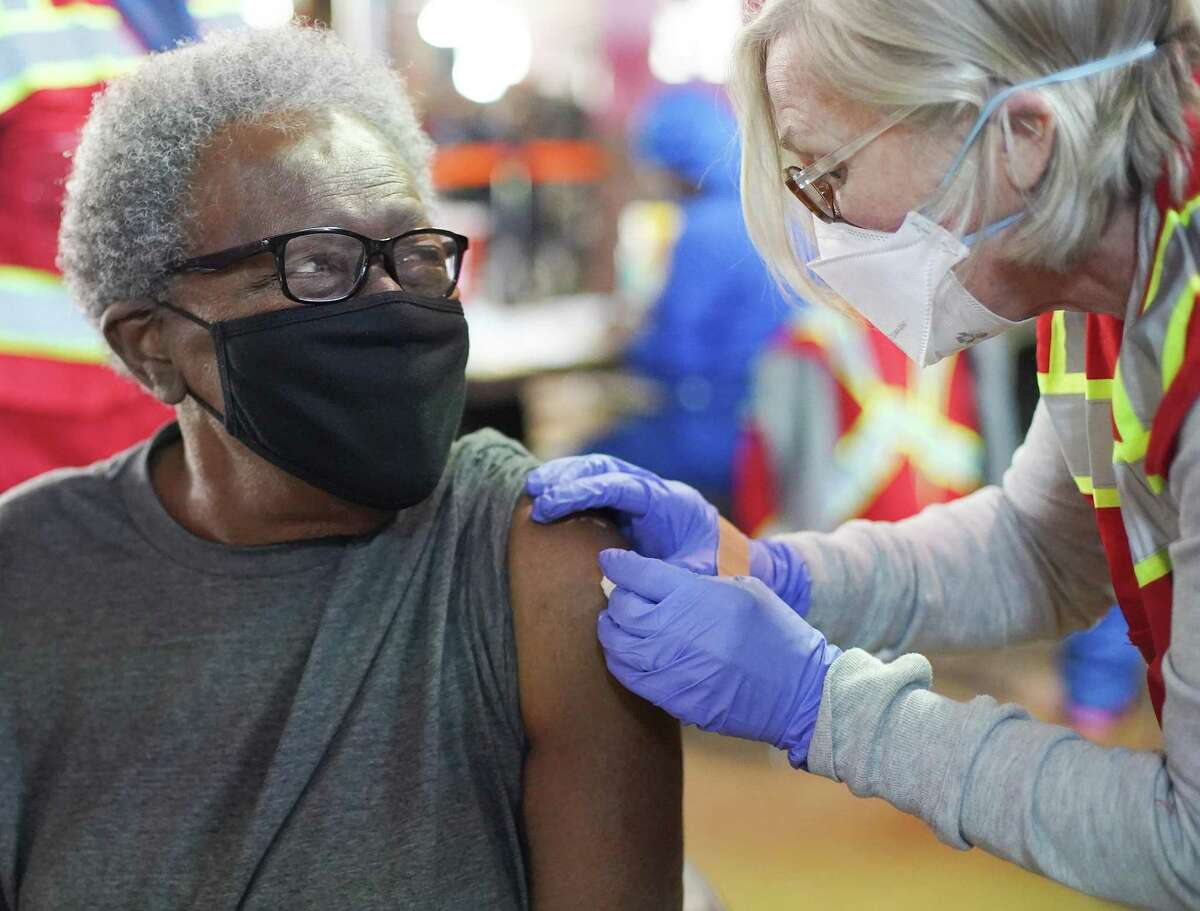 Perline Lockett, 86, gets her COVID-19 shot by nurse practitioner Jill Atmar on the concourse of Minute Maid Park on Saturday, Jan. 16, 2021. The mega-distribution site administered 5000 COVID vaccines on Saturday.