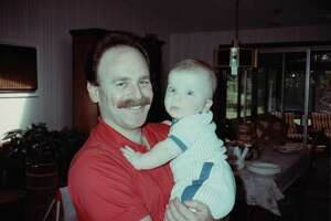 Michael Reiter holding his son Adam as an infant.