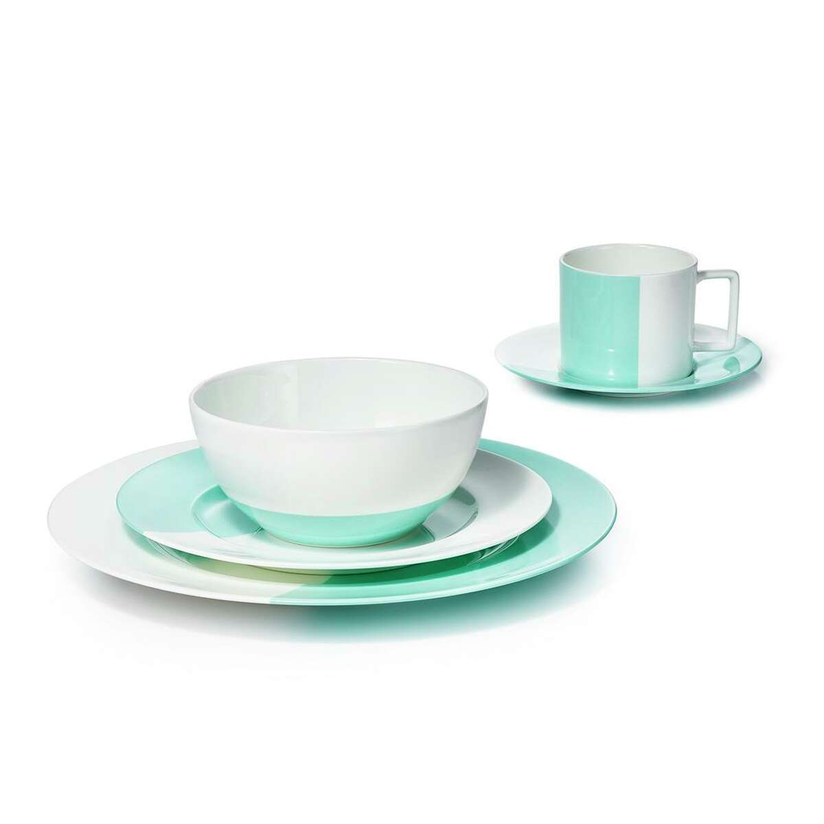 Tiffany brings a fresh and modern perspective to its Color Block Collection, blending soft ivory with its signature robin's egg blue in dishes, napkins and placemats. $320 per place setting, $125 set of 4 napkins, $175 set of 4 placemats; Tiffany & Co.