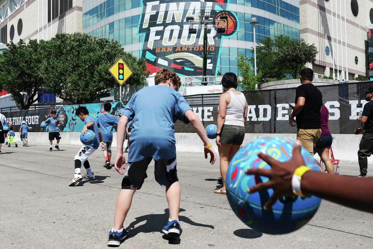 """Thousands of children participate in the NCAA Final Four Dribble on April 1, 2018, near the Alamodome. The San Antonio City Council on Thursday authorized a """"clean zone"""" in the downtown area for the 2021 NCAA women's basketball tournament, March 16-April 4."""