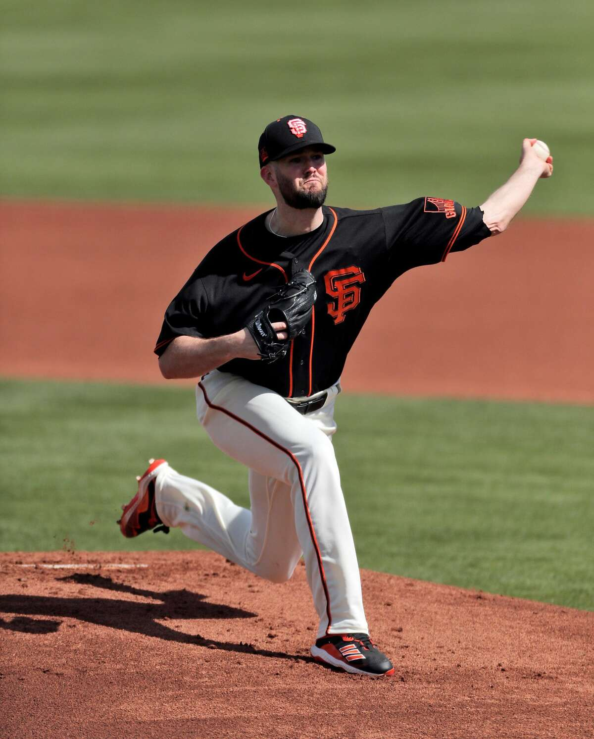 Alex Wood (57) pitches in the first inning as the San Francisco Giants played the Chicago White Sox in a spring training game at Scottsdale Stadium in Scottsdale, Ariz., on Thursday, March 4, 2021.