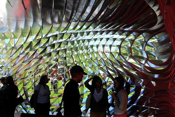 Visitors chat inside the International Festival of Arts & Ideas visitors pavilion on the New Haven G during a past year's festival. Some of the festival's events, such as outdoor concerts, could happen this year after the pandemic turned last year's festival virtual.