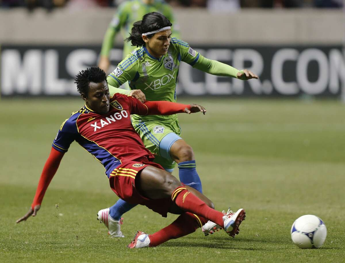 SANDY, UT - NOVEMBER 8: Kenny Mansally #29 of Real Salt Lake and Fredy Montero #17 of the Seattle Sounders fight for the ball during the second half of an MLS Western Conference Semifinals play-off soccer game November 8, 2012 at Rio Tinto Stadium in Sandy, Utah. Seattle Sounders beat Real Salt Lake 1-0. (Photo by George Frey/Getty Images)
