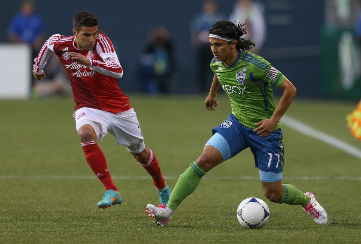 SEATTLE, WA - OCTOBER 07: Fredy Montero #17 of the Seattle Sounders FC dribbles against the Portland Timbers at CenturyLink Field on October 7, 2012 in Seattle, Washington. (Photo by Otto Greule Jr/Getty Images)