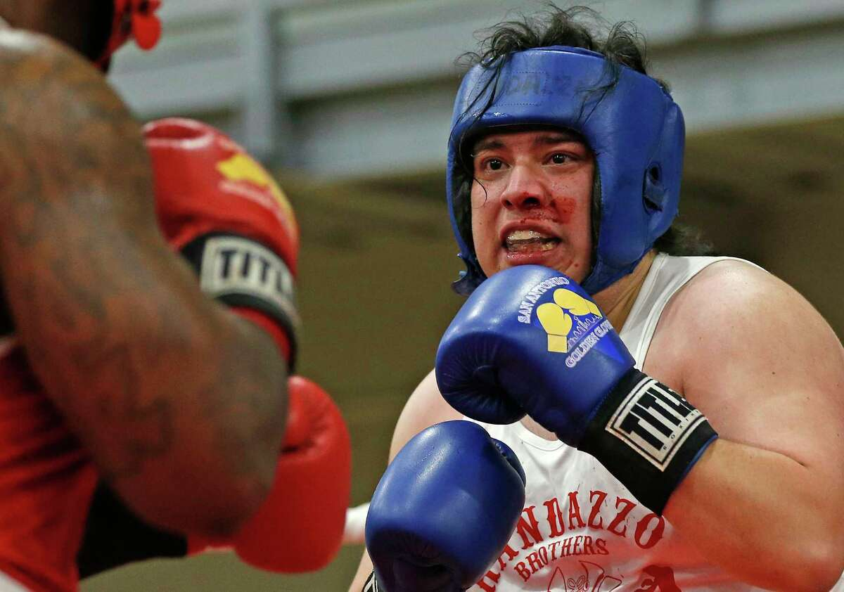 Paul Chavera,Randazzo Boxing Gym, fought gamely but not defeat Danny McCalls,Dead Game. Golden Gloves matches at George Gervin Wellness Center on Saturday, Feb. 13,2021.