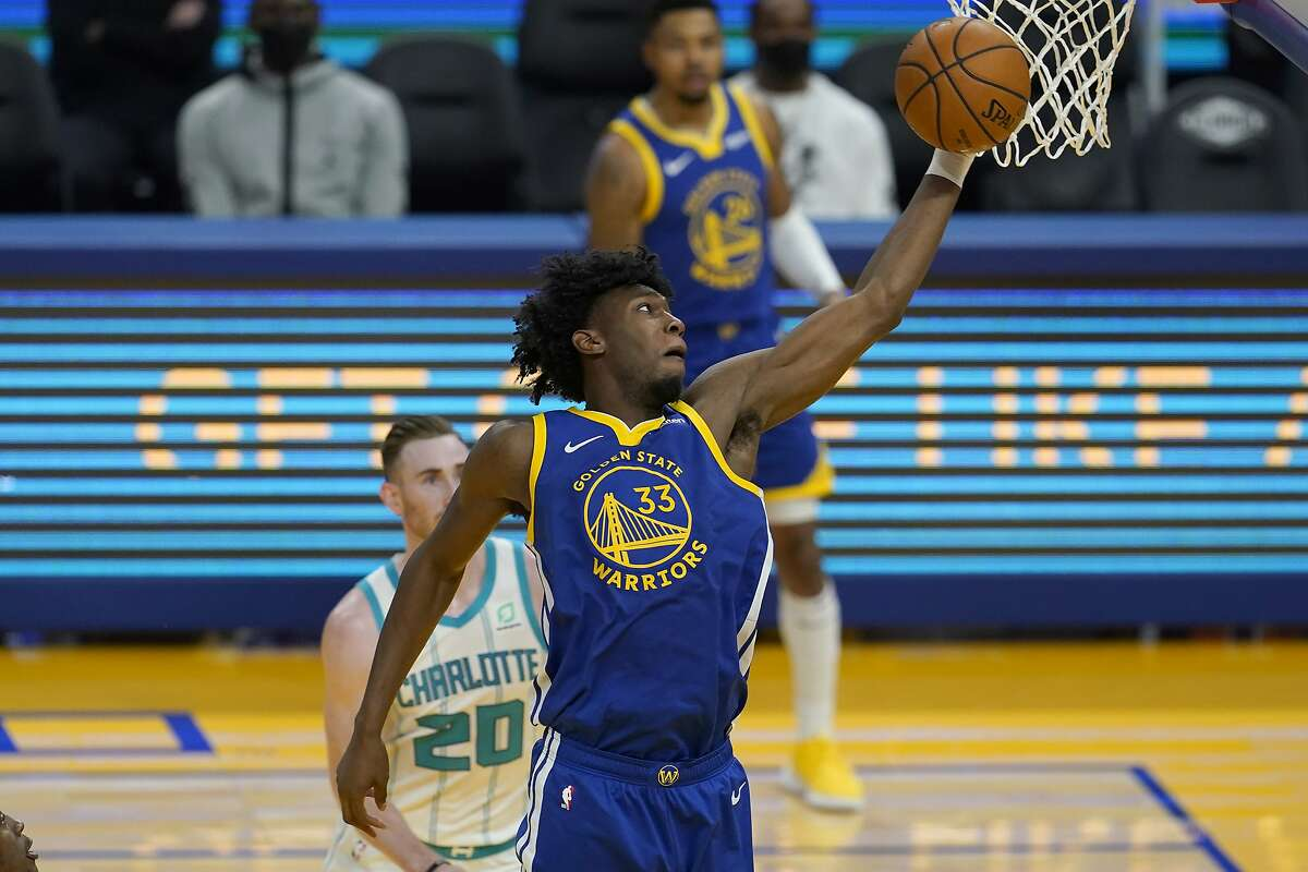 Golden State Warriors center James Wiseman (33) against the Charlotte Hornets during an NBA basketball game in San Francisco, Friday, Feb. 26, 2021. (AP Photo/Jeff Chiu)