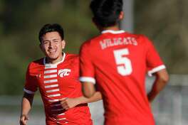 Splendora's Hector Villegas (14) reacts toward Ivan Olguin (5) after scoring a goal during the first period of a high school soccer match Thursday, March 4, 2021, in Splendora.