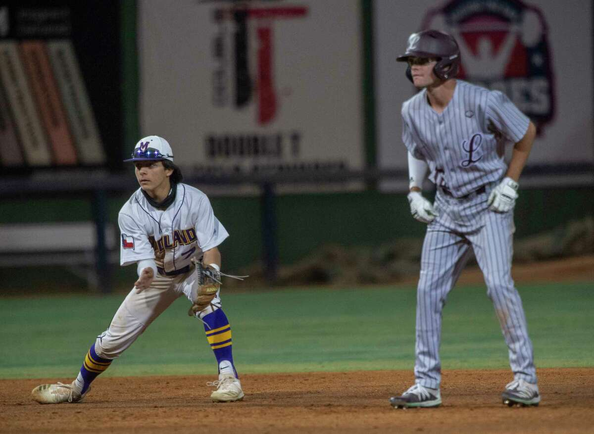 Midland High's Nautas Weiershauen tries to distract Lee High base runner Tanner Hedrick as he leads off second 03/04/2021 night at Momentum Bank Ballpark during the Tournament of Champions. Tim Fischer/Reporter-Telegram