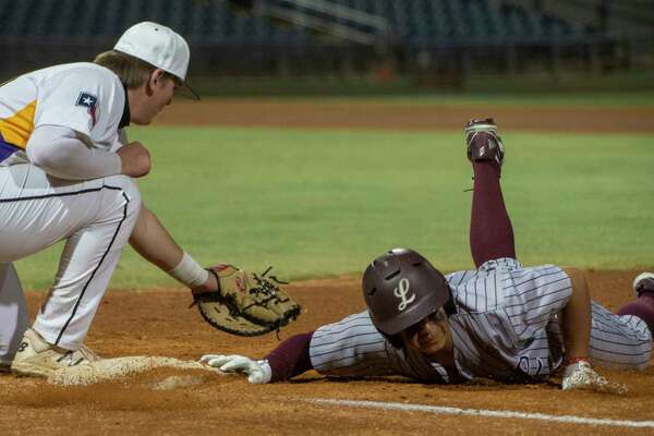 Lee High's Raymond Vasquez dives back to first to beat the tag by Midlanbd High's Pierce Mackey 03/04/2021 night at Momentum Bank Ballpark during the Tournament of Champions. Tim Fischer/Reporter-Telegram