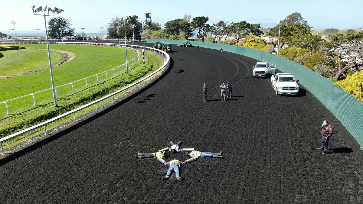 Four San Francisco Bay Area residents locked themselves together on the Golden Gate Fields racing track, canceling horse races on Thursday, March 4, 2021, in Albany, CA.