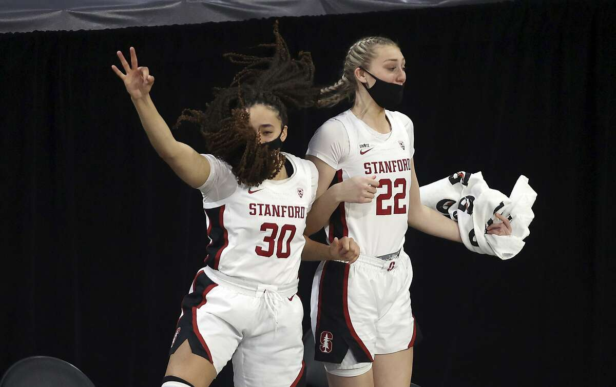 Stanford guard Haley Jones (30) and forward Cameron Brink (22) celebrate after a 3-point shot during the second half of the team's NCAA college basketball game against Southern California in the second round of the Pac-12 women's tournament Thursday, March 4, 2021, in Las Vegas. (AP Photo/Isaac Brekken)