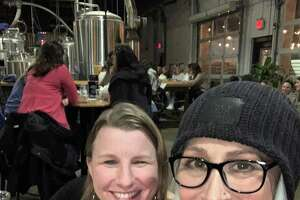 Christine Surel, at right, was at Tribus Beer Co. on Wednesday, March 3, 2021, one of her first times going out after nearly a year with a long-haul case of COVID-19. Surel, a lifetime Milford resident, was with her friend Meredith D'Agostino, center.