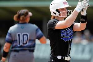 FILE — Sam Graeter #3 of Oak Ridge reacts after hitting an RBI triple during the first inning of a District 15-6A high school softball game at College Park High School, Wednesday, March 11, 2020, in The Woodlands.