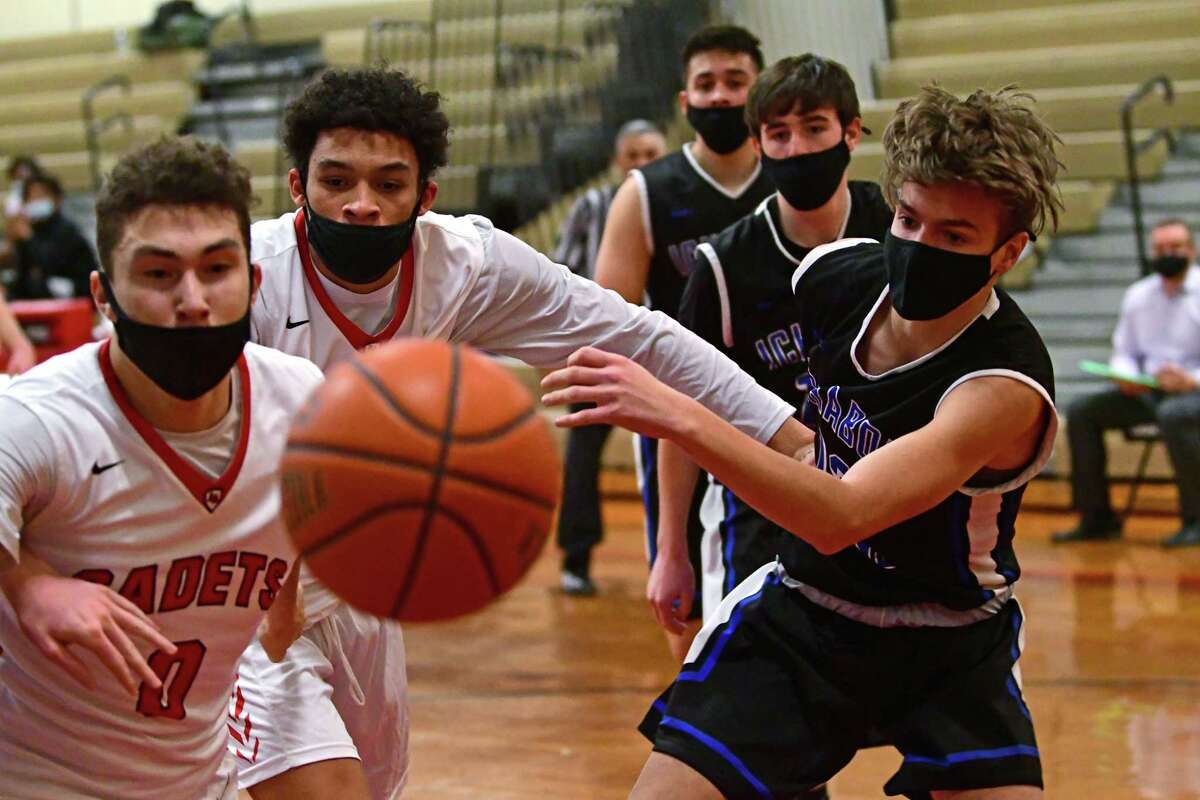 Players from Albany Academy and Ichabod Crane go after a loose ball under the hoop during a basketball game against Ichabod Crane on Thursday, March 4, 2021 in Albany, N.Y. (Lori Van Buren/Times Union)