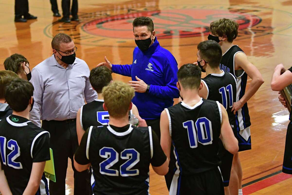 Ichabod Crane head coach Will Ferguson talks to his players during a basketball game against Albany Academy on Thursday, March 4, 2021 in Albany, N.Y. (Lori Van Buren/Times Union)