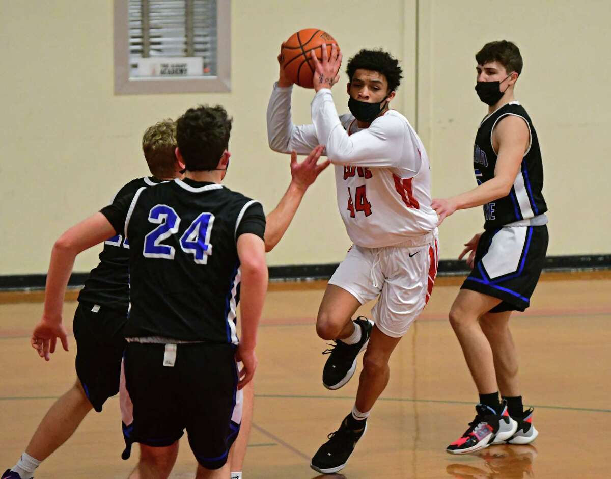 The senior point guard concluded his scholastic career Saturday by pouring in 45 points in leading the Cadets past La Salle 77-73. Here, Jackson drives to the hoop during a basketball game against Ichabod Crane on Thursday, March 4, 2021.