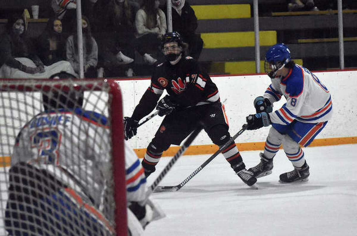 Edwardsville's Anthony Ruklic skates down the wing towards the goal during the first period against Freeburg-Waterloo inside the East Alton Ice Arena.