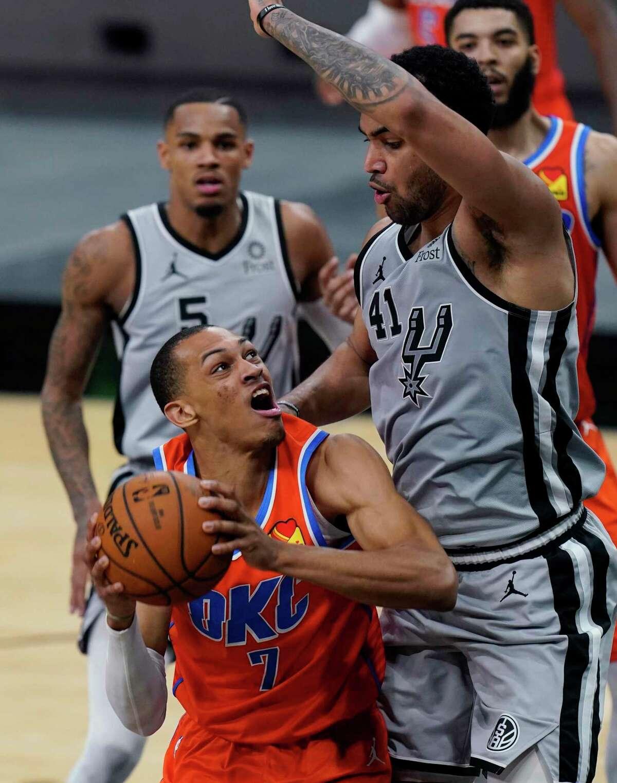 Oklahoma City Thunder forward Darius Bazley (7) looks to score past San Antonio Spurs forward Trey Lyles (41) during the second half of an NBA basketball game in San Antonio, Thursday, March 4, 2021. (AP Photo/Eric Gay)
