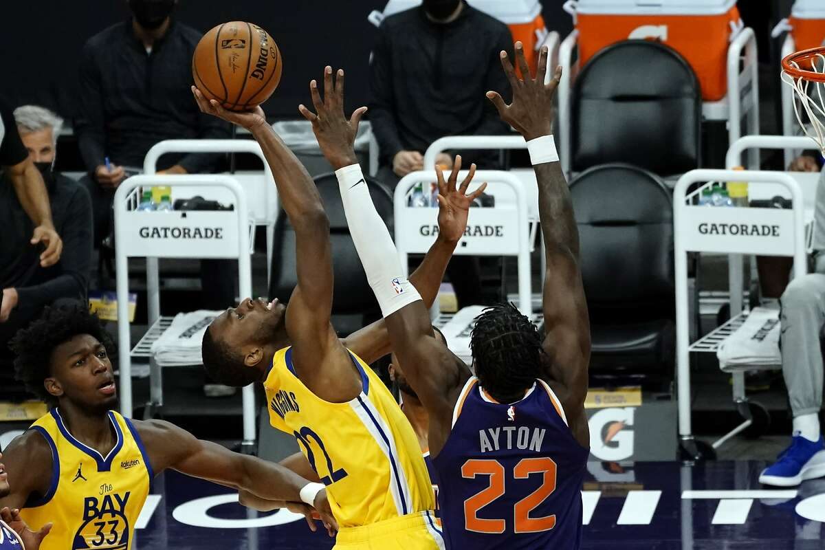 The Warriors' Andrew Wiggins drives on the Suns' Deandre Ayton in the first half in Phoenix, where Golden State rested its biggest star and went with a sort of youth movement - including expanded minutes for James Wiseman, below - then lost.