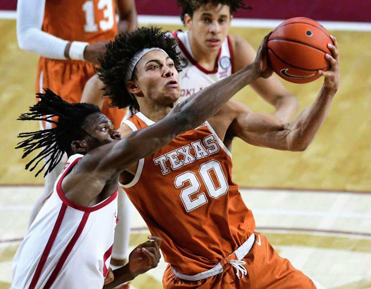 Texas senior forward Jericho Sims (20) finished with 16 points and a team-high 12 rebounds, helping lead the Longhorns past Oklahoma.