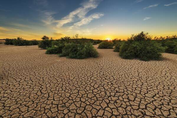 """History of droughts in the U.S. Defined by the National Weather Service as """"a shortage of water over an extended period of time,"""" droughts are a normal and natural part of Earth's weather cycle. Sometimes, however, a lack of water is far more significant than just a cyclical dry spell. Although tornadoes, hurricanes, tsunamis, and fires are more dramatic and alarming, severe droughts are often far more widespread, more devastating, more expensive, and harder to manage than the violent natural disasters that tend to grab headlines. Making matters worse, droughts can create or encourage a range of secondary environmental catastrophes like fires, crop failures, mudslides, sinkholes, destroyed roadways, massive fish kills, locust swarms, and-although it seems counterintuitive-severe floods. Throughout U.S. history, droughts have turned vast swaths of farmland to dust, created panic, killed millions of cattle and other animals, and forced widespread human migration, financial depression, and starvation. The worst droughts, however, have also sparked major reforms.In California, for instance, droughts led to creation of the Central Valley Project, the State Water Project, the urban conservation movement, and the Drought Emergency Water Bank. The direct and indirect costs of drought total more than $9 billion a year in the United States alone, and that expense is set to rise as droughts become more prevalent and severe. Although global warming is often portrayed in the media as a debate, there is direct and irrefutable evidence linking climate change to increased instances of severe drought beyond the dry spells that are a natural part of the planet's cycles. Warming temperatures over the past century have directly contributed to major droughts across the country, but particularly in the American West. It was only in 2019 that California finally got relief from a catastrophic dry spell that defined the state's ecology throughout much of the past decade. Stacker dived intot"""