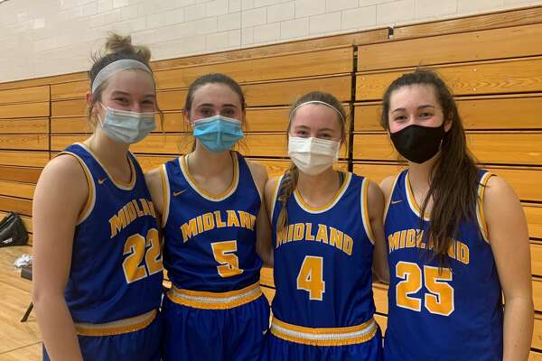 Midland High seniors (from left) Anna Tuck, Olivia Carpenter, Emma Rekeweg, and Sydnie Schafer are chasing an elusive SVL and district title this season. They will meet crosstown rival Dow High in a big showdown next Friday at the Chargers' gym.