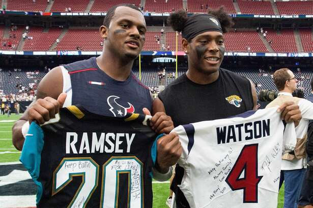 Deshaun Watson #4 of the Houston Texans and Jalen Ramsey #20 of the Jacksonville Jaguars exchange jerseys after the game at NRG Stadium on September 10, 2017 in Houston, Texas. (Photo by Bob Levey/Getty Images)