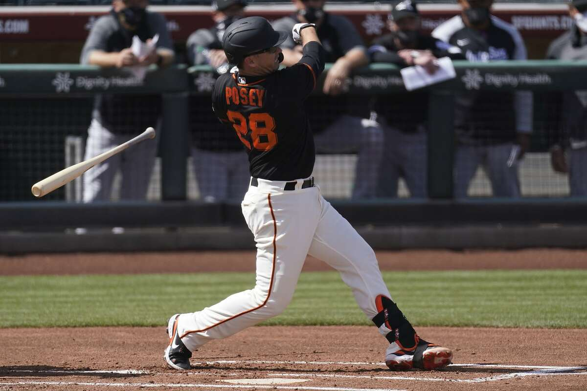 San Francisco Giants catcher Buster Posey (28) lets go of his bat as he swings during the first inning of a spring training baseball game against the Chicago White Sox Thursday, March 4, 2021, in Scottsdale, Ariz. (AP Photo/Ashley Landis)