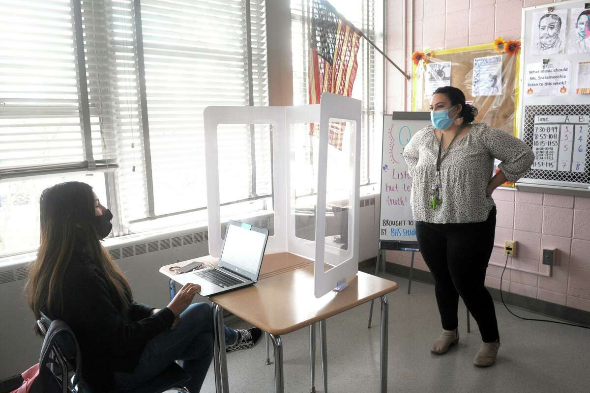 World history teacher Michelle Scatamacchia speaks with freshman Adrianna Nunez during the question and answer session of a special Black history presentation at Bunnell High School, in Stratford, Conn. March 4, 2021. Current students and faculty also watched an online panel discussion given by Black alumni from the school.