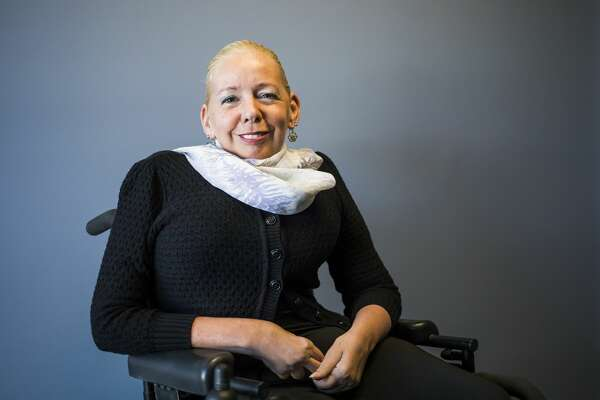 Disability Network of Mid-Michigan Executive Director Kelly PeLong poses for a portrait Monday, March 1, 2021 inside the DNMM offices in Midland. (Katy Kildee/kkildee@mdn.net)