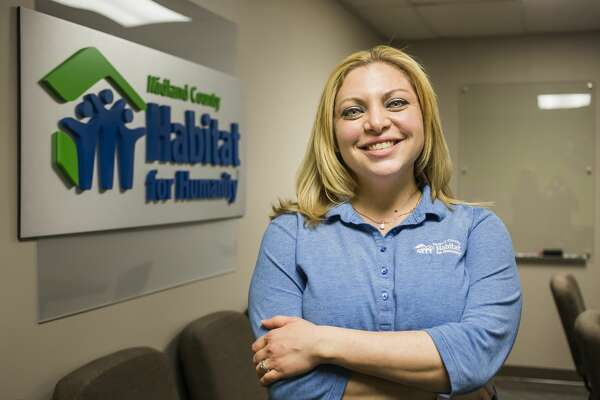 Midland County Habitat for Humanity President and CEO Jennifer Chappel poses for a portrait Wednesday, March 3, 2021 at the Habitat for Humanity offices in Midland. (Katy Kildee/kkildee@mdn.net)