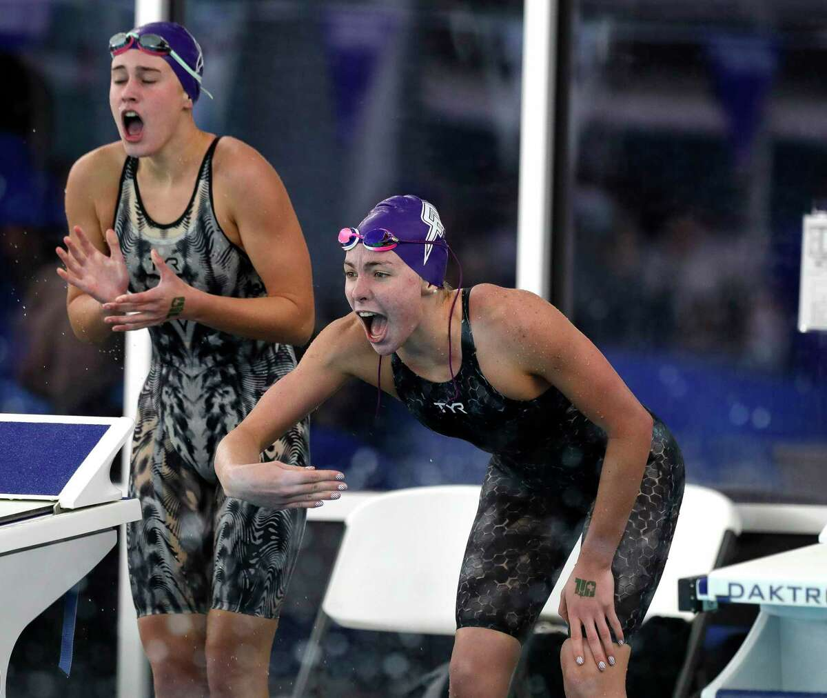 Fulshear swimmers cheer as they compete in the Class 5A girls 200-yard freestyle relay during the UIL State Swimming & Diving Championships, Tuesday, March 2, 2021, in San Antonio.