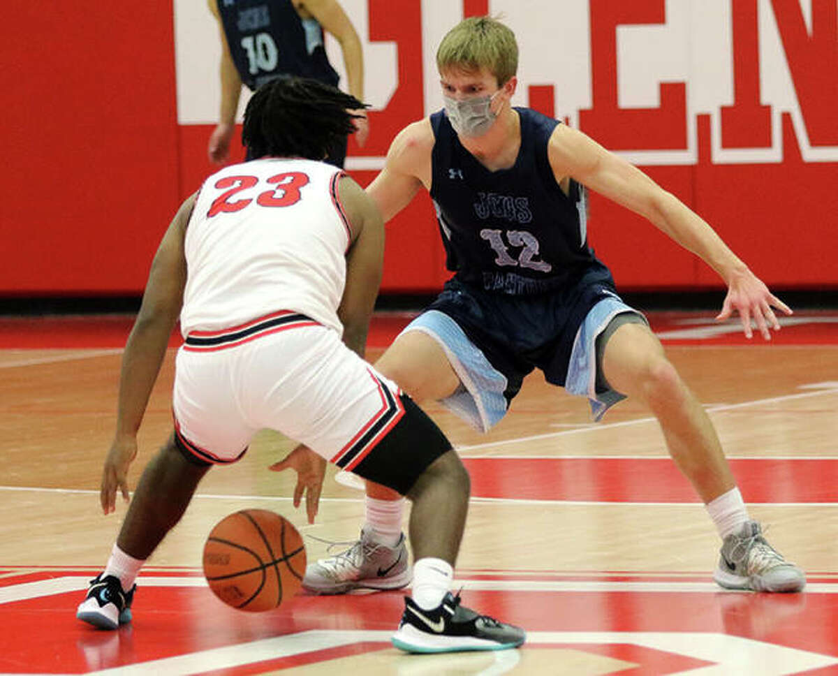 Jersey's Andrew Kribs (right) scored 15 points and helped Jersey knock off Waterloo in prep boys basketball action Thursday in Jerseyville. he is shown guarding a Chatham Glenwood player earlier this season.