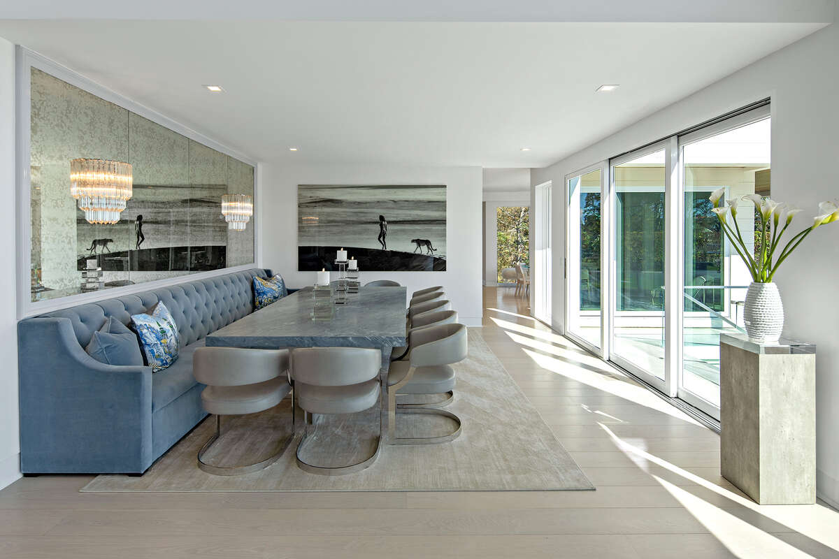 Dining room with smoked glass mirrored wall at 10 Gray Lane, Westport.