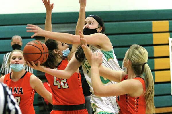 Southwestern's Korrie Hopkins (middle) puts up a shot between Pana defenders during a Feb. 19 game in Piasa. Hopkins and the Piasa Birds take a 9-1 record into weekend home games vs. Vandalia on Friday and Hillsboro on Starurday.