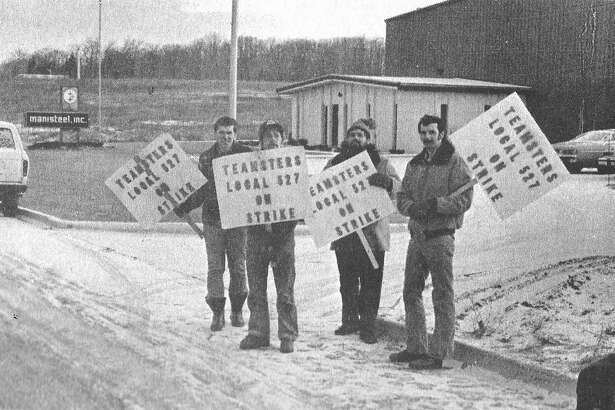 This photo was published in the News Advocate on March 6,1981. Four Manistee employees who said they have been locked out of their jobs since Dec. 23 went on strike this morning to protest their company's unwillingness to negotiate a contract which expired Dec. 8. (From left) Teamsters Local 527 members Stan Gajeski, Ron Kissel, George Yaworski and Dennis Hindman manned the picket lines this morning.(Manistee County Historical Museum photo)