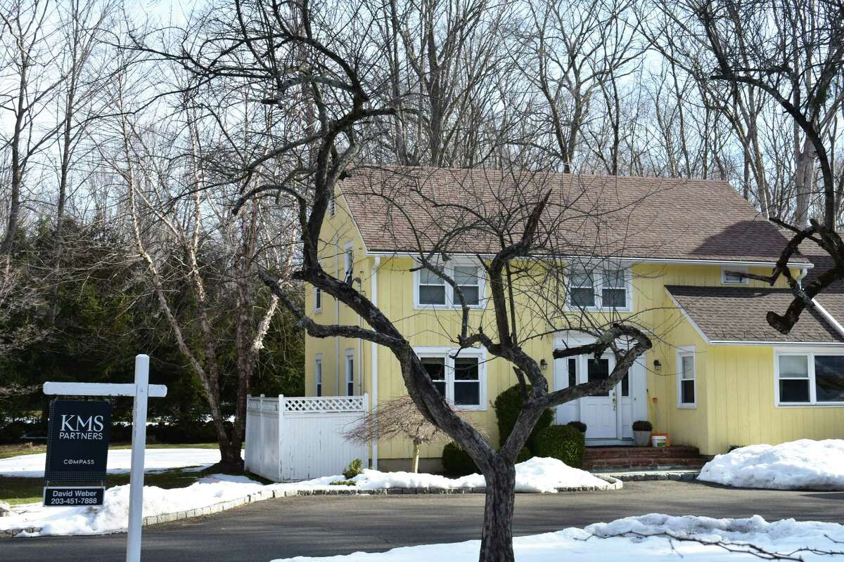 A Godfrey Road home in Weston, Conn., listed for sale at the outset of the pandemic in 2020 and again heading into the spring of 2021, for just under $650,000.