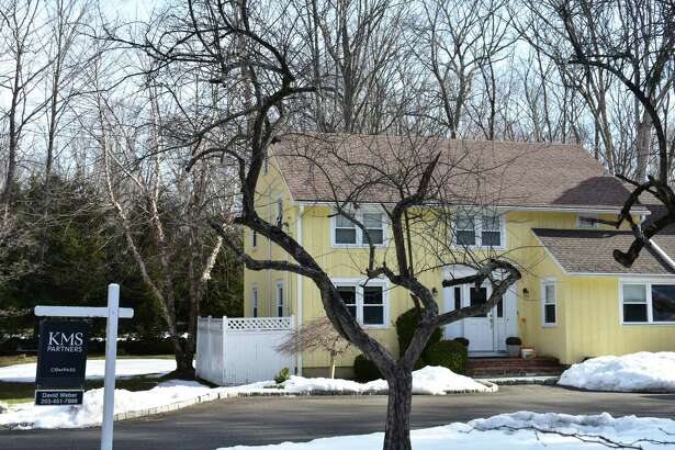 A Godfrey Road home in Weston, Conn., listed for sale at the outset of the pandemic in 2020 and again heading into the spring of 2021, for just under $650,000. The listing could soon see price competition on nearby Ravenwood Drive, via the foreclosure auction of a home that carries a slightly lower assessed value, if the auction proceeds in March as scheduled.