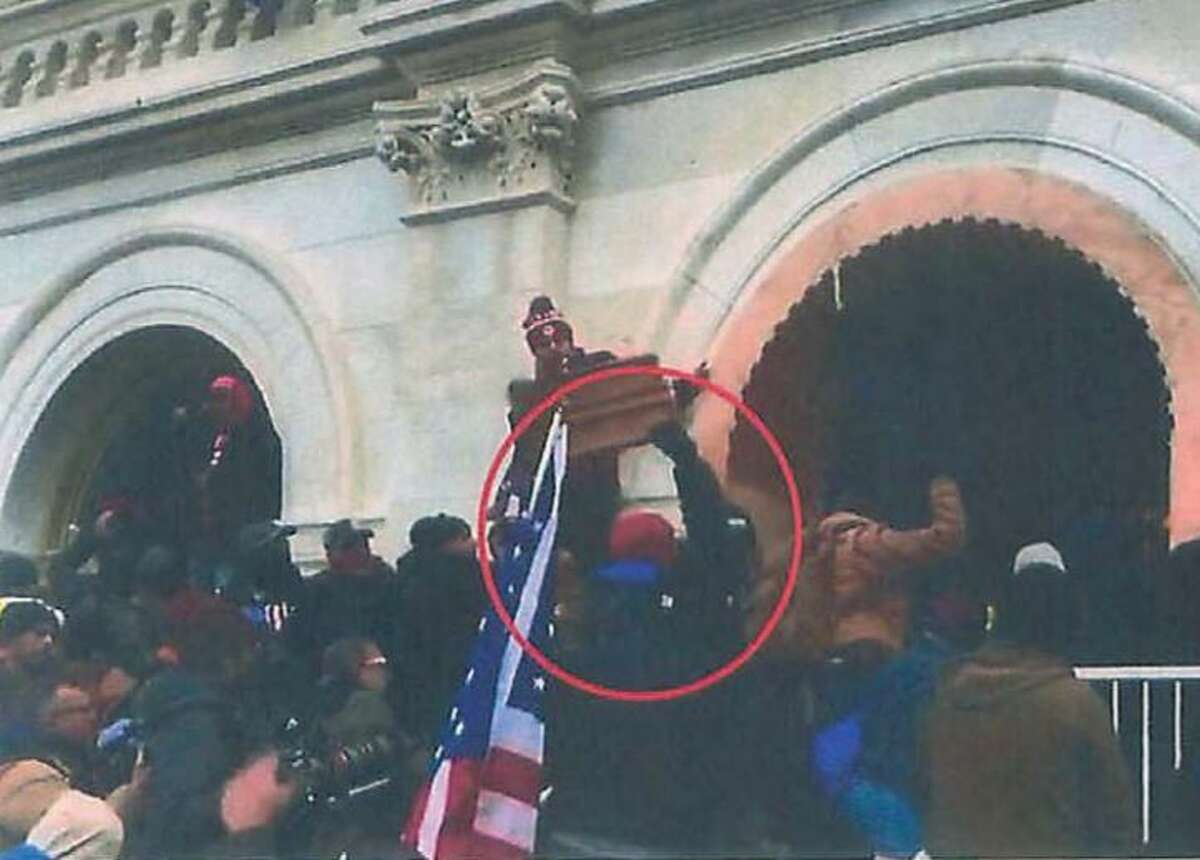 Shane Jenkins of Houston can be seen throwing items at law enforcement officers barricading a tunnel Jan. 6 at the U.S. Capitol, according to a screen grab included in a criminal complaint.