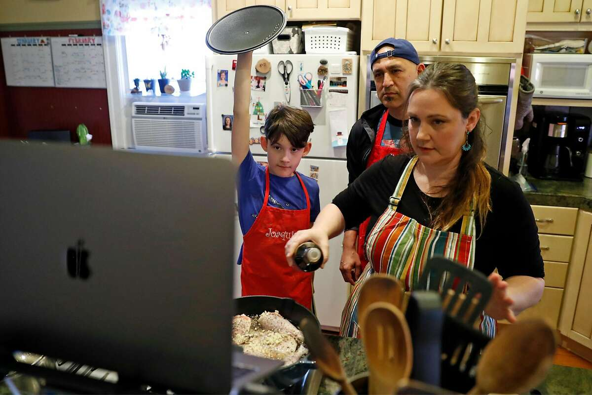 Rudy Gonzalez and Katie Yates and their son, Joaquin, 11, join in from their kitchen in San Jose, Calif. as Broadway veteran Aaron Albano teaches his mother's adobo chicken recipe as part of Playful People Productions' interactive online cooking class.