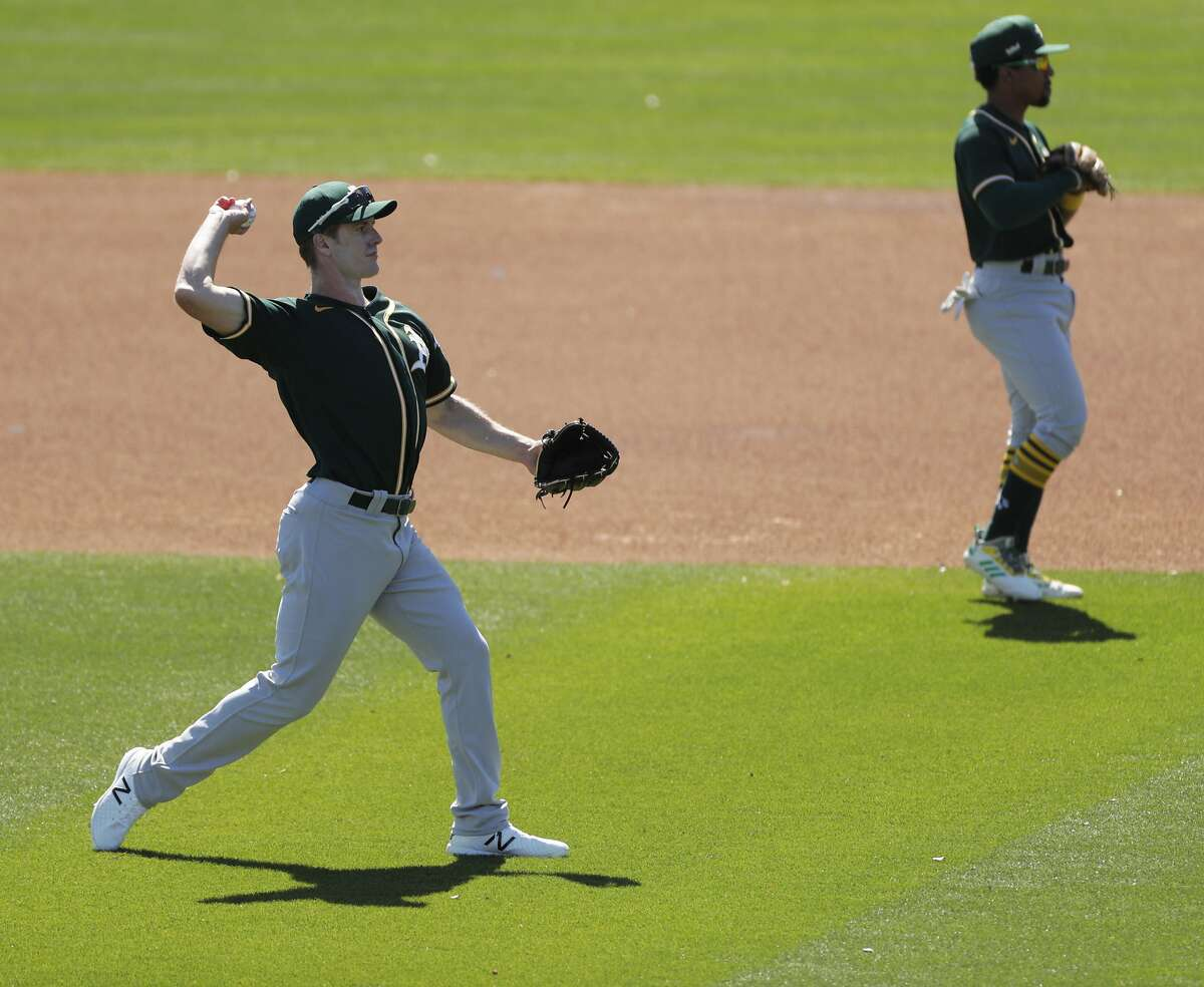 Mark Canha warms up before the game between the Oakland Athletics and Milwaukee Brewers at American Family Fields in Phoenix, Ariz., on Tuesday, March 2, 2021
