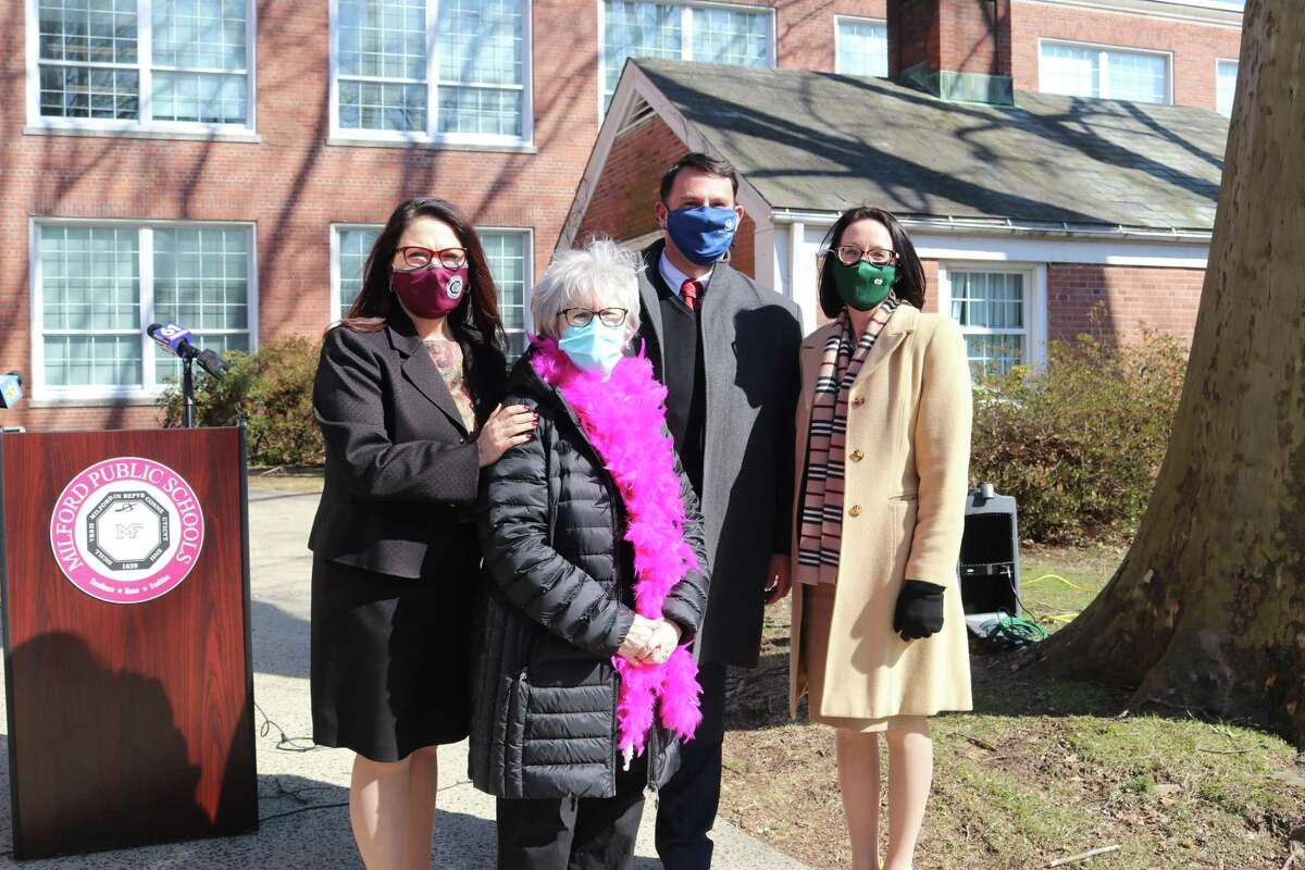 Peggy Kelly, (second from left) receives congratulations from Superintendent of Schools Dr. Anna Cutaia, Mayor Ben Blake, and Assistant Superintendent of Schools Dr. Amy Fedigan.