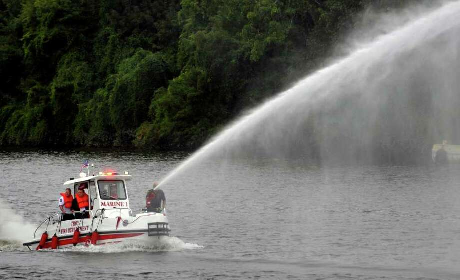 The Troy Fire Department demonstrates its new boat on the Hudson River in Troy on Wednesday, September 8, 2010.  The deluge gun was shooting from 500-700 gallons of water from the river per minute, and has a capacity of up to 1,000 gallons per minute. ( Philip Kamrass / Times Union ) Photo: Philip Kamrass