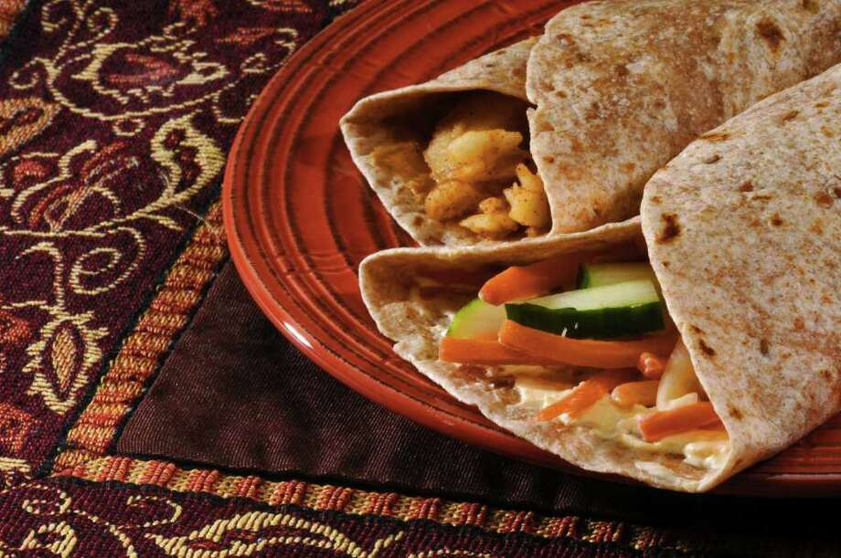 Wraps filled with apples, peanut butter or cream cheese make a great lunch alternative or healthy breakfast option. (Philip Kamrass / Times Union) Photo: PHILIP KAMRASS / 00009452A