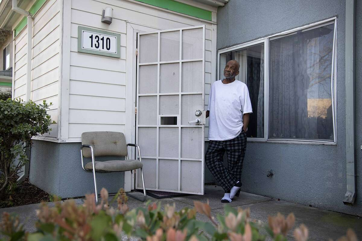 Robert Brisco, 68, says he'll wait longer before he gets a Covid-19 vaccine while standing a his home near the RingCentral Coliseum on Thursday, March 4, 2021 in Oakland, Calif. The state recently announced that it's now prioritizing certain zip codes for the vaccine.