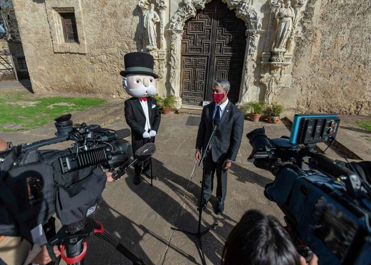 Uncle Pennybags, aka the Monopoly Man, stands with Mayor Ron Nirenberg at Mission San José on Thursday as officials gathered to announce the newly approved San Antonio version of the famed Hasbro game, Monopoly. San Antonians can submit locally related ideas for the game through March 17 at sanantonio@toptrumps.com.
