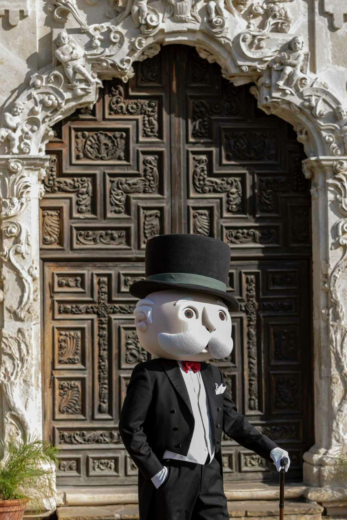 Uncle Pennybags, aka the Monopoly Man, leans on his walking stick Thursday, Feb. 4, 2021, in front of Mission San José during an announcement that Hasbro is releasing a San Antonio version of the official Monopoly game. Tops Trump is producing the game for Hasbro, which is expected to be released in September.